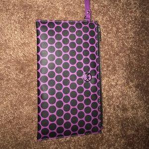 Purple and Black polkadotted Michael Kors wristlet